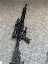 AR-15 with vortex strike eagle 1-6 magnification scope.