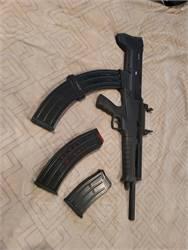 Semi auto self defense Rock Island 12GA